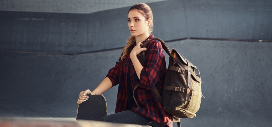 a-student-girl-with-a-backpack-wearing-a-checkered